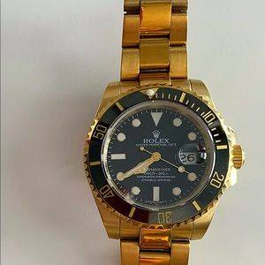 Rolex Gold Black submariner 116660
